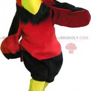 Czerwony i żółty Sęp maskotka z czarnymi spodenkami -
