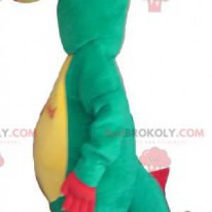 Lustiges grünes rotes und gelbes Dinosauriermaskottchen -