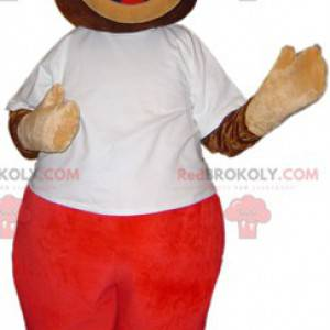 Niedźwiedź brunatny maskotka w białym i czerwonym stroju -