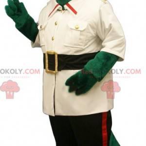 Zelený krokodýlí maskot oblečený jako průzkumník -