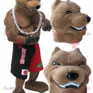 Gigantyczna i muskularna maskotka psa rasy w stroju boksera -