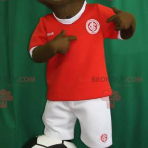 Young African boy mascot in footballer outfit - Redbrokoly.com