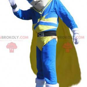 Superhero vigilante mascot in blue and yellow outfit -