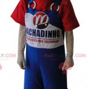 Maskottchenjunge im blauen Overall und im roten T-Shirt -
