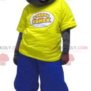 Černý chlapec maskot oblečený ve žluté a modré barvě -