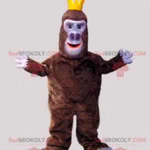 Braunes Gorilla-Affen-Maskottchen mit einer Krone -