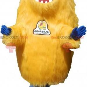Haariges gelbes Kreaturenmaskottchen. Grizzly Maskottchen -
