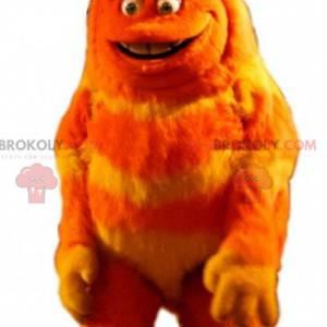 Orange and yellow hairy monster mascot. Hairy creature -