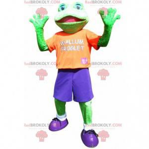 Zelená žába maskot oblečený v barevné sportovní oblečení -