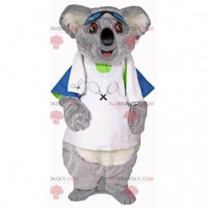Mascotte koala grigio e bianco in abbigliamento da tennis -