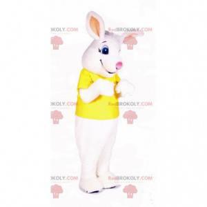 Maskot bílý králík oblečený ve žlutém tričku - Redbrokoly.com