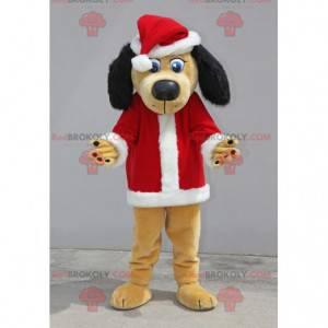 Béžový a černý pes maskot oblečený jako Santa Claus -