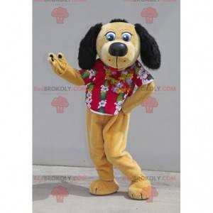 Beige und schwarzes Hundemaskottchen mit einem Blumenhemd -