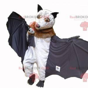 Braunes und schwarzes weißes Fledermausmaskottchen mit seinem