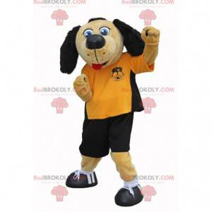 Beige and black dog mascot in footballer outfit - Redbrokoly.com