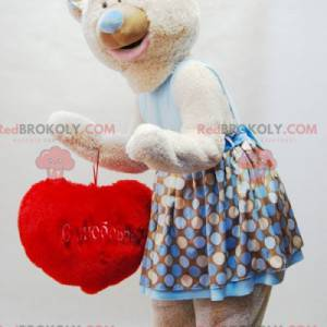 Beige teddy bear mascot with a dress and a red heart -