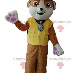 Brown and white dog mascot with a yellow vest - Redbrokoly.com