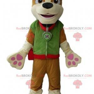 Brown dog mascot dressed in a green outfit - Redbrokoly.com