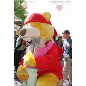 Big yellow and red bear mascot with a cap - Redbrokoly.com