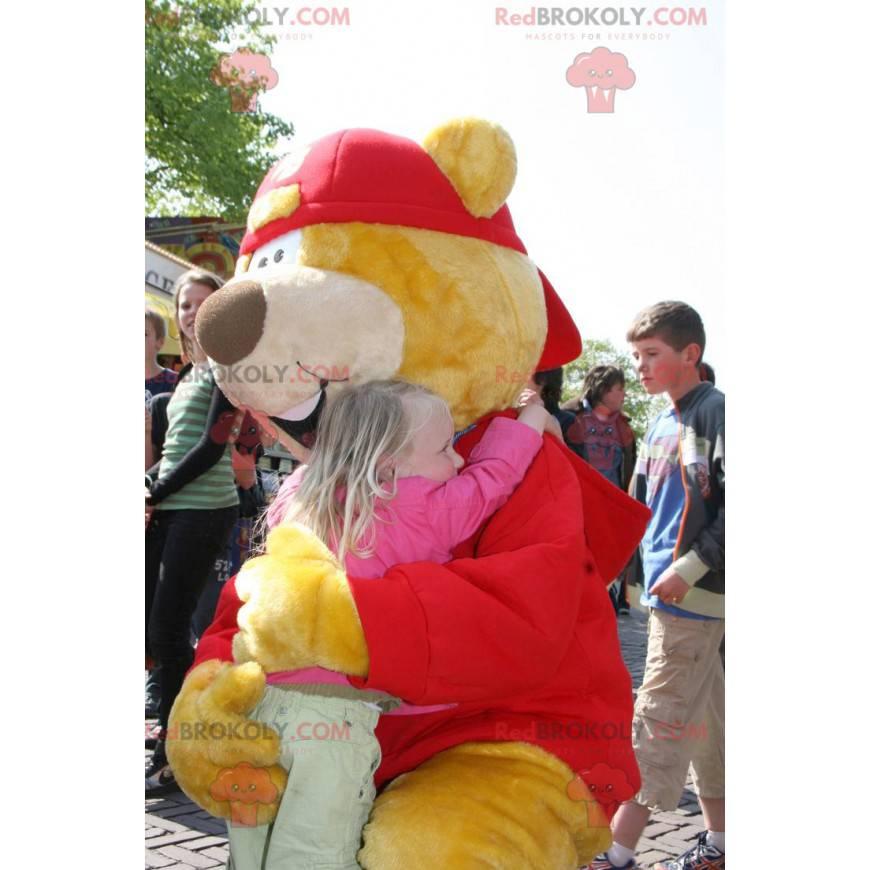 Velký žlutý a červený medvěd maskot s čepicí - Redbrokoly.com
