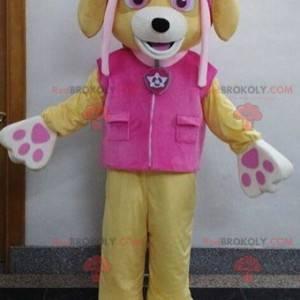 Béžový psí maskot s růžovým oblečením - Redbrokoly.com