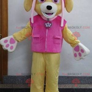 Beiges Hundemaskottchen mit einem rosa Outfit - Redbrokoly.com