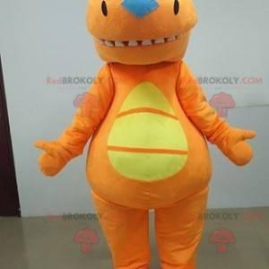 Oranžový a žlutý dinosaurus maskot. Oranžový oblek -