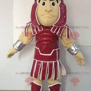 Gladiator Maskottchen in einem roten Outfit gekleidet -