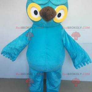 Giant blue and yellow owl mascot with big eyes - Redbrokoly.com