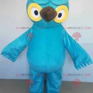 Gigantisk blå og gul ugle maskot med store øyne - Redbrokoly.com
