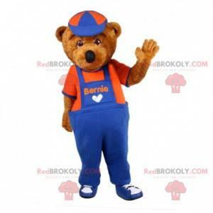 Hnědý medvídek maskot oblečený v montérkách - Redbrokoly.com