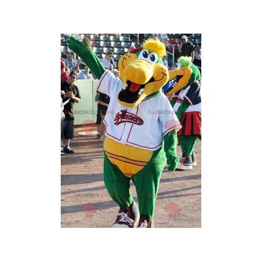 Green and yellow crocodile mascot smiling - Redbrokoly.com