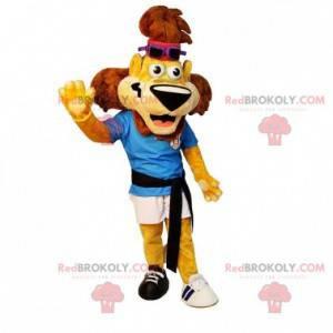 Žlutý a hnědý maskot sportovního lva ve sportovním oblečení -