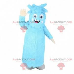 Blaues haariges Monstermaskottchen. Blauer haariger Anzug -