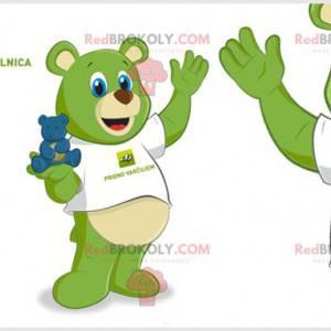 Grünes Teddybärmaskottchen mit blauen Augen. Grüner Teddybär -