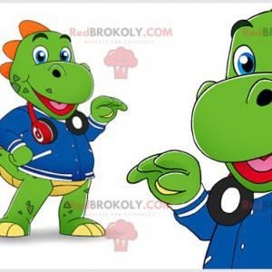 Zelený maskot dinosaura se sluchátky a bundou - Redbrokoly.com