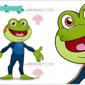 Grünes Froschmaskottchen mit einer blauen Kombination -