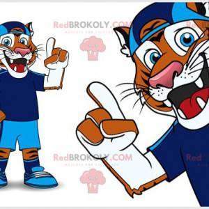 Orange and white tiger mascot in blue sportswear -