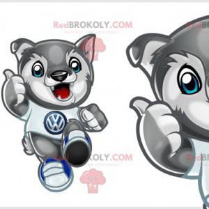 Maskot malý šedý a bílý vlk s modrýma očima. Mládě -