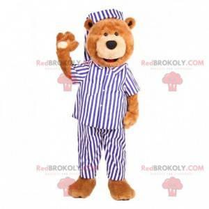 Teddybär Maskottchen in einem blau-weißen Pyjama gekleidet -