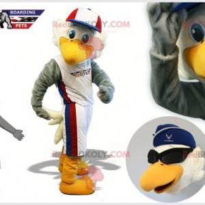 Gray and white eagle mascot in sportswear - Redbrokoly.com