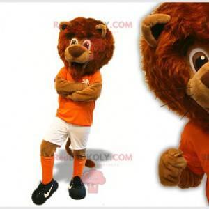 Brun løve maskot i fotballspiller - Redbrokoly.com