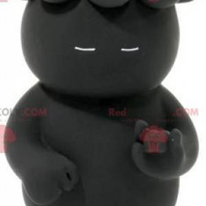Maskottchen schwarzer Kobold mit Jungen auf dem Kopf -