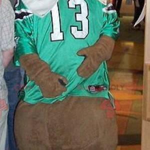 Maskot medvěd hnědý se zeleným a bílým sportovním dresem -