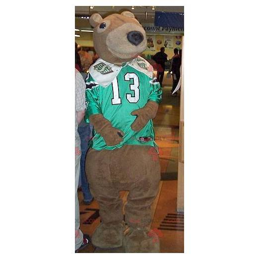 Brown bear mascot with a green and white sports jersey -