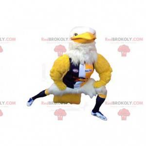 Gelbes und weißes Adlermaskottchen mit Sportbekleidung -