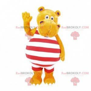Mascote hipopótamo amarelo com uma roupa vermelha e branca -