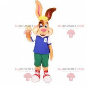 Hnědý a bílý béžový králičí maskot s barevným oblečením -