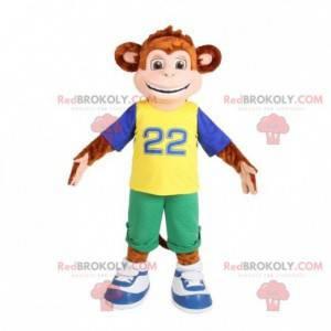 Brązowa małpa maskotka ubrana w kolorowy strój - Redbrokoly.com