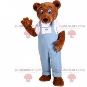 Hnědý medvídek maskot oblečený v džínové kombinéze -